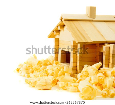 Woodworking. House construction. Joiner's works. The wooden house and shaving on white background. - stock photo