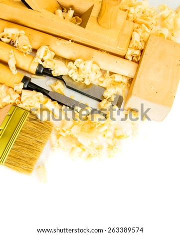 Woodworking. Joiner's works. Joiner's tools (brush, chisel, hammer) on a white background. - stock photo