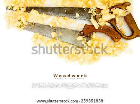 Woodworking. Joiner's works. Wooden shaving and saw on white background. - stock photo