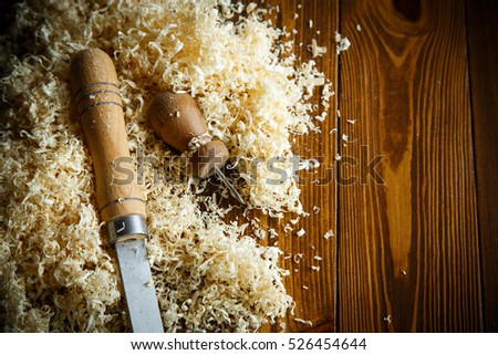 Woodworking tools. Chisel with sawdust .