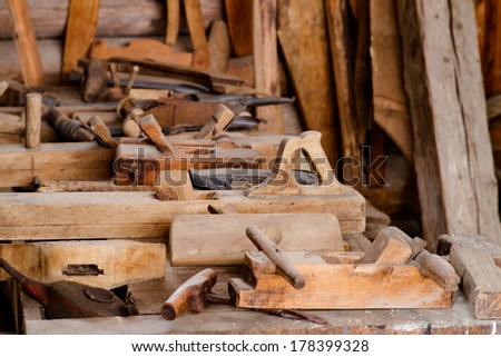 Woodworking tools with wooden background - stock photo