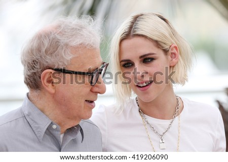 woody allen and kristen stewart attend cafe society photocall during the 69th cannes film festival  at palais du festival in Cannes, 11 may 2016. - stock photo