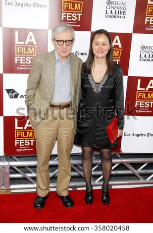 """Woody Allen and Soon-Yi Previn  at the 2012 Los Angeles Film Festival premiere of """"To Rome With Love"""" held at the Regal Cinemas L.A. LIVE Stadium 14, Los Angeles, USA on June 14, 2012. - stock photo"""