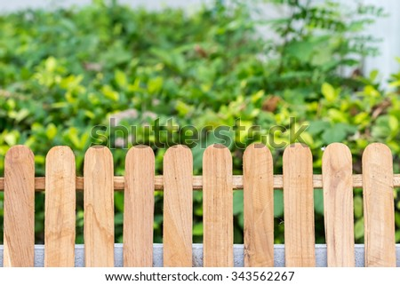 Woody fence in garden.
