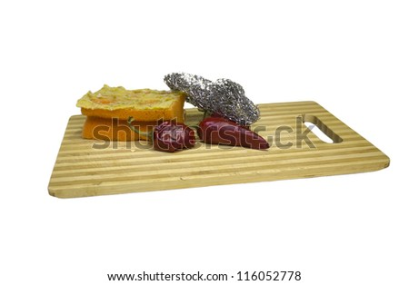 Wool and the board for the meat on a white background - stock photo