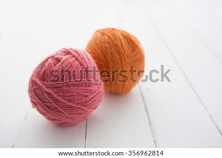 Wool on weathered white wood table background - stock photo