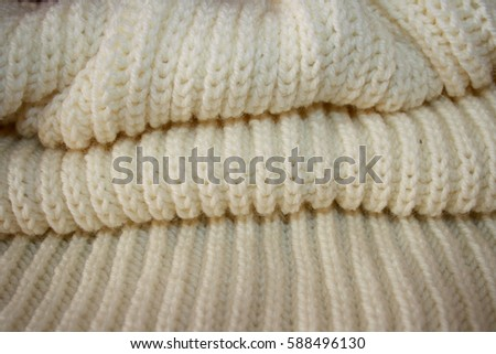 Wool products handmade from a large white knitted