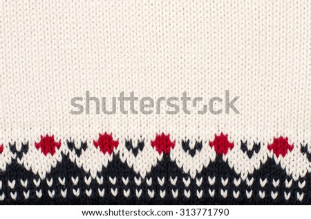 Wool sweater pattern as a background. Close up on winter motif knit woolen texture. - stock photo