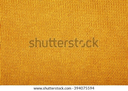 Wool sweater texture close up. Knitted jersey background with a relief pattern. Braids in machine knitting pattern - stock photo