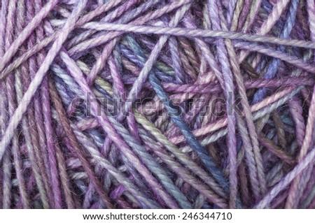 wool yarn clew macro colorful blue purple - stock photo