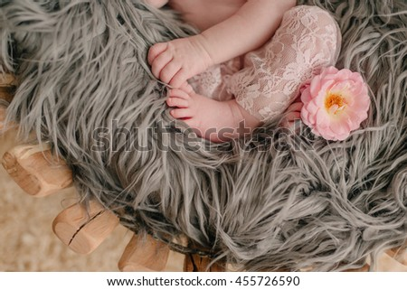 woolen blanket on the legs and handles in a baby pink lace - stock photo