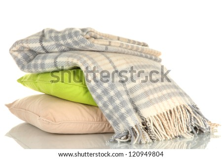 Woolen checkered plaid and pillows, isolated on white