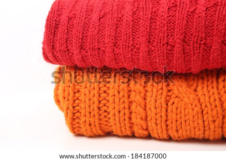 Woolen knitted clothes background - stock photo