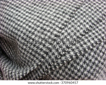 woolen material in houndstooth texture, background