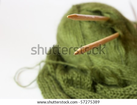 woolen thread and knitting needles