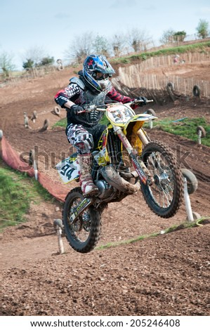 WORCESTER,UK - APRIL 05 2009 :Competitors taking part in a Motocross race.Motocross is a popular motor sport with venues in many countries around the world.Youngsters as young as 4  can take part  - stock photo