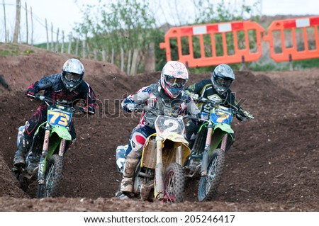 WORCESTER,UK - APRIL 05 2009 :Competitors taking part in a Motocross race.Motocross is a popular motor sport with venues in many countries around the world.Youngsters as young as 4  can take part