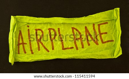 word airplane on crumpled paper - stock photo
