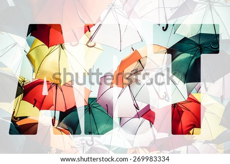 Word ART over colorful umbrellas. - stock photo