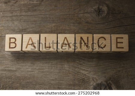 word BALANCE on a wooden background - stock photo