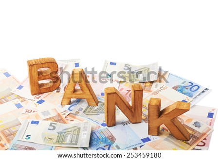 Word Bank over the surface covered with the euro bank note bills - stock photo