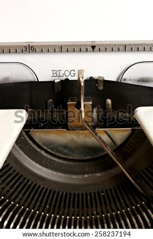 Word BLOG written on an old typewriter - stock photo