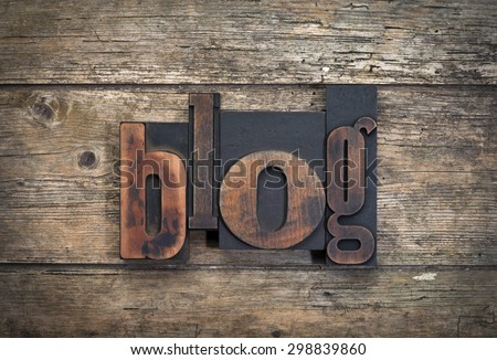 """word """"blog"""" written with vintage letterpress printing blocks on rustic wood background - stock photo"""