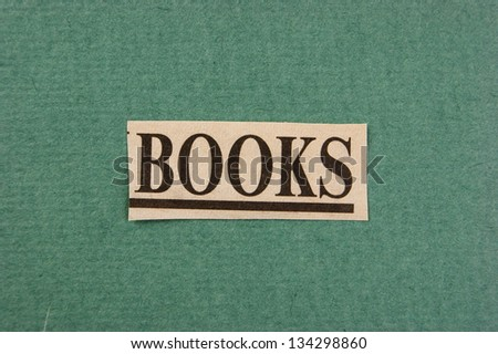 word books cut from newspaper on green background - stock photo