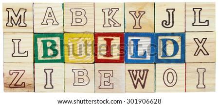 "Word ""BUILD"" from alphabet wooden blocks - stock photo"