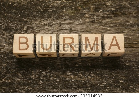 Word BURMA on a wooden background