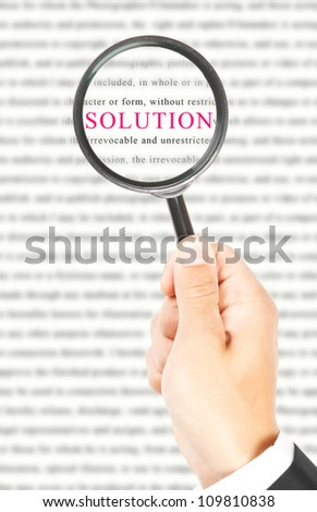 Word business written on paper and seen through a magnifying glass - stock photo