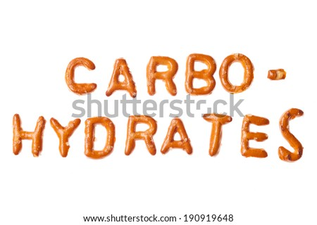 Word CARBOHYDRATES written, laid-out, with crispy alphabet pretzels isolated on white background - stock photo