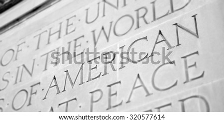 Word Carved in Stone Granite American - stock photo