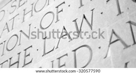 Word Carved in Stone Granite Law - stock photo