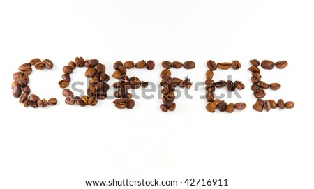 Word coffee spelled with whole beans - stock photo