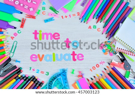 word color letter time to evaluate on gray wooden table