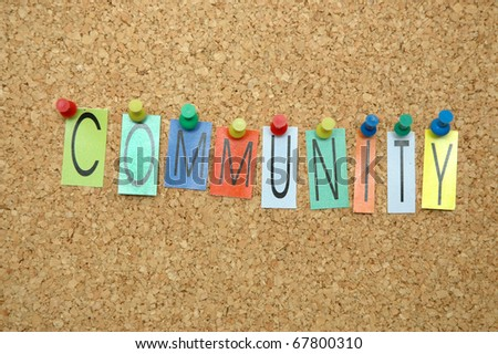 "Word ""Community "" placed from colourful small letters on the cork board"