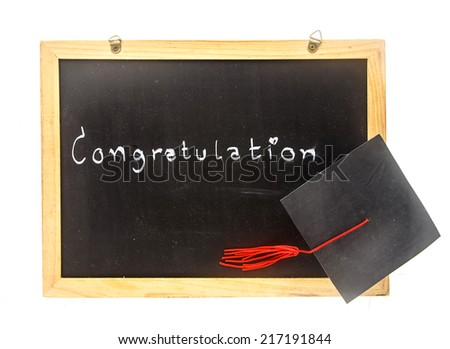 word -  congratulation  on board with graduation hat in white - stock photo
