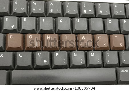 Word contact spelled on computer keyboard.