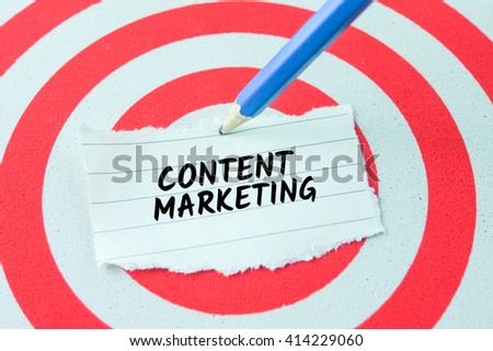 word content marketing on note paper stick on dart board with pencil,target concept - stock photo