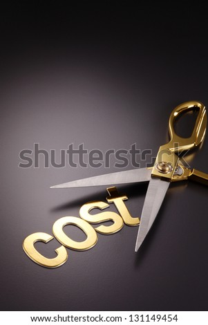 word cost next to the scissors - stock photo