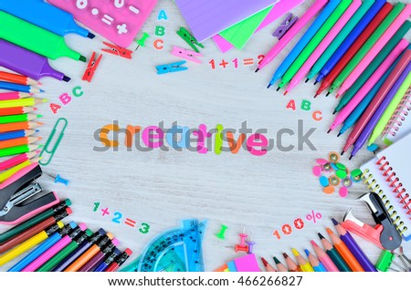 word creative colors letters and stuff for school on gray wooden desk