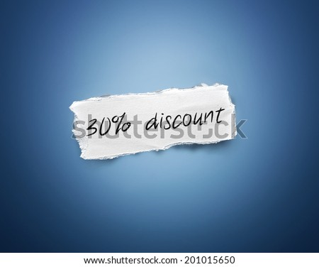 Word - 30% discount - written on a torn rectangular scrap of white paper on a blue background with a vignette - stock photo