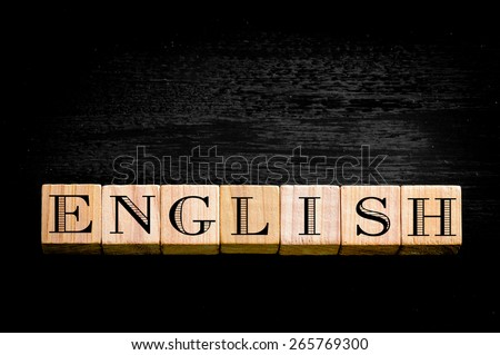 Word English.Wooden small cubes with letters isolated on black background.Concept image.