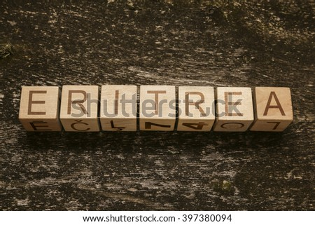 Word ERITREA on a wooden background - stock photo