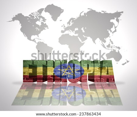 Word Ethiopia with Ethiopian Flag on a world map background - stock photo