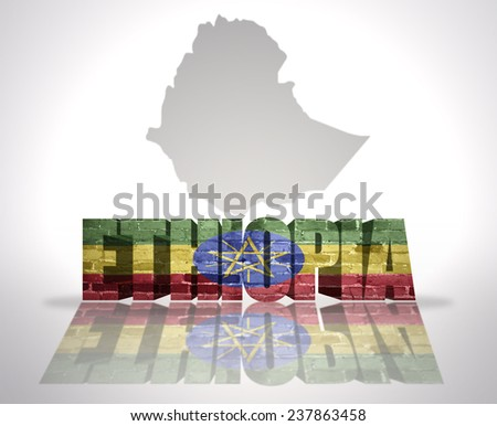 Word Ethiopia with National Flag near map of Ethiopia - stock photo