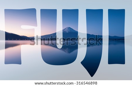 word FUJI transparent over mountain Fuji at dawn with peaceful lake reflection