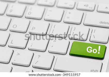 word go written on a green computer keyboard key or button