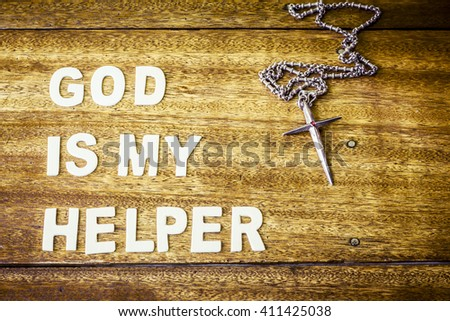 """word """" God is my helper"""" design by wooden letter press and metal cross on wooden background - stock photo"""